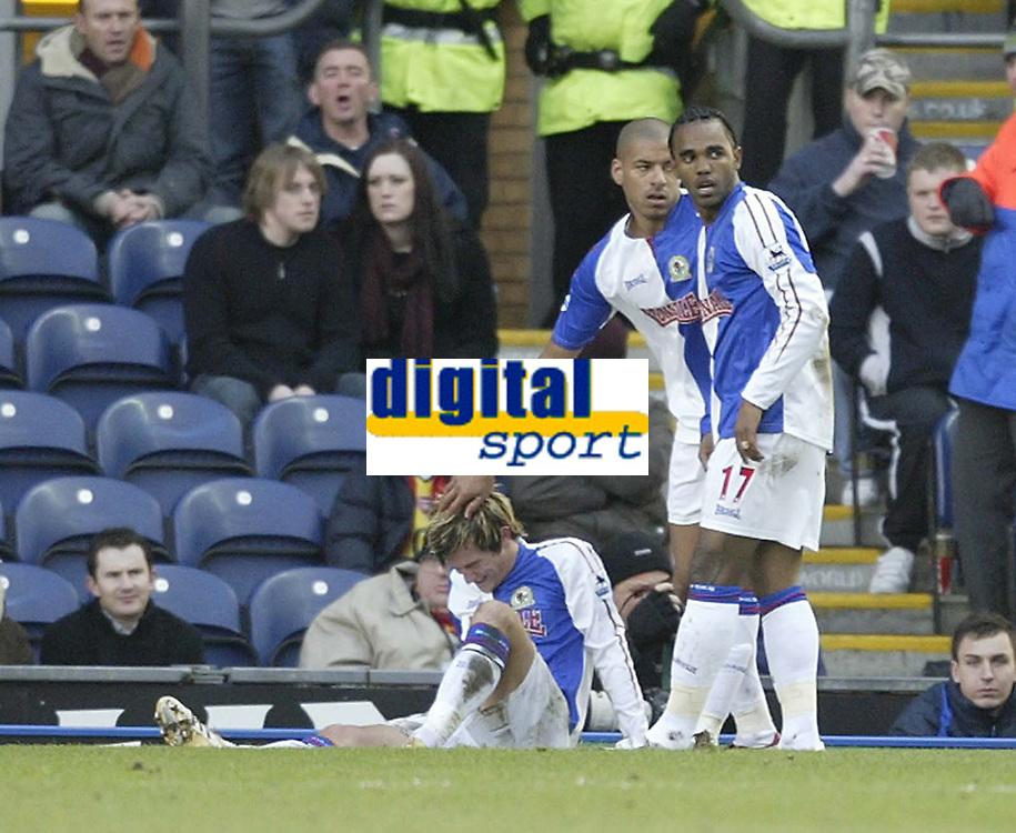 Photo: Aidan Ellis.<br /> Blackburn Rovers v Arsenal. The Barclays Premiership. 25/02/2006.Blackburn's Steven Reid and Florent Sinama Pongolle congratulate ijured goal scorer Morten Gamst Pedersen