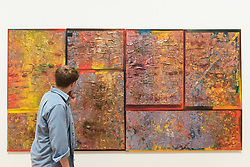 """© Licensed to London News Pictures. 30/05/2019. LONDON, UK. A staff member views """"Girls in the City"""", 1991, by Frank Bowling at a preview of works by artist Frank Bowling (born in Guyana in 1934).  The retrospective exhibition spans his six-decade career and takes place 31 May to 26 August 2019 at Tate Britain.  Photo credit: Stephen Chung/LNP"""