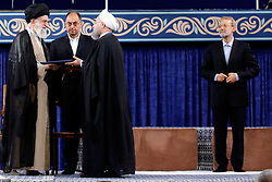 Handout photo - Iranian supreme leader Ayatollah Ali Khamenei shows him (L) gives his official seal of approval during the swearing in ceremony of President Hassan Rouhani to serve his second term, in Tehran, Iran, on August 3, 2017. Photo via Parspix/ABACAPRESS.COM