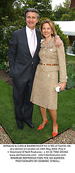 ARNAUD & CARLA BAMBERGER he is MD of Cartier UK. at a dinner in London on 24th May 2004.PUJ 4