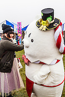 Japanese celebrate the silly, eccentric and adorable like no other country.  Its obsession with the yuru-kyara mascots is a perfect example of this.  These mascots represent products, teams, museums, schools, prisons, branches of the military, organizations  and even the national tax office.   Most towns, counties, and companies have their own yuru-kyara mascot, following this craze. Creepy or cute, they lurk around street fairs, community events, train stations and tourist destinations.  There are large Mascot Summits such as the one in Hanyu, Saitama held every year where mascots campaign and are voted on.  Mascots normally represent local culture or products. They may be created by local government or other organizations to stimulate tourism and economic development, or created by a company to build on their corporate identity. They may appear as costumed lovable characters at promotional events and festivals meant to convey affection for one's hometown or region.