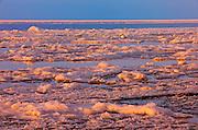 sunset over ice on Lake Manitoba<br /> Delta Marsh<br /> Manitoba<br /> Canada