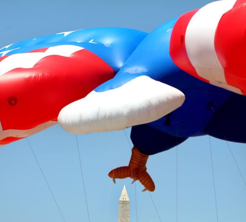 An inflatable eagle stands on the National Mall, awaiting procession into the National Independence Day Parade in Washington, D.C.