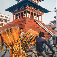 Pidicab drivers relax under a temple in Kathmandu, Nepal, 1986.