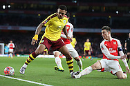 Andre Gray of Burnley stamps on the foot of Laurent Koscielny of Arsenal. The Emirates FA cup, 4th round match, Arsenal v Burnley at the Emirates Stadium in London on Saturday 30th January 2016.<br /> pic by John Patrick Fletcher, Andrew Orchard sports photography.