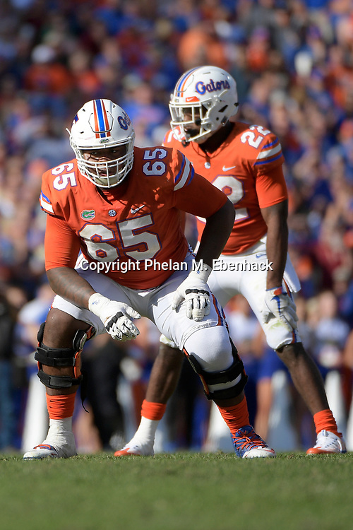 Florida offensive lineman Jawaan Taylor (65) lines up at the line of scrimmage for a play during the second half of an NCAA college football game against Florida State Saturday, Nov. 25, 2017, in Gainesville, Fla. FSU won 38-22. (Photo by Phelan M. Ebenhack)