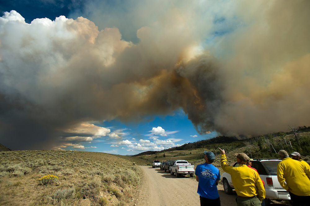 PRICE CHAMBERS / NEWS&GUIDE<br /> The Red Rock fire in the Gros Ventre sends a plume of smoke skyward as wind pushes it through heavy timber east of Crystal Creek on Monday. The fire on the Bridger-Teton National Forest approximately 26-miles northeast of Jackson and has burned 2,835 acres as of Tuesday afternoon. The fire is predicted to continue moving eastward into Alkali basin as firefighters consider lighting a backfire along the Gros Ventre road to remove fuels between the fire and the road in an effort to keep the blaze where managers want it to be.
