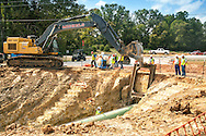 David Hightower questons if the Keystone Pipeline is being put in deep enough beneath the road.  Constuction workers burrow under the road across from his house.