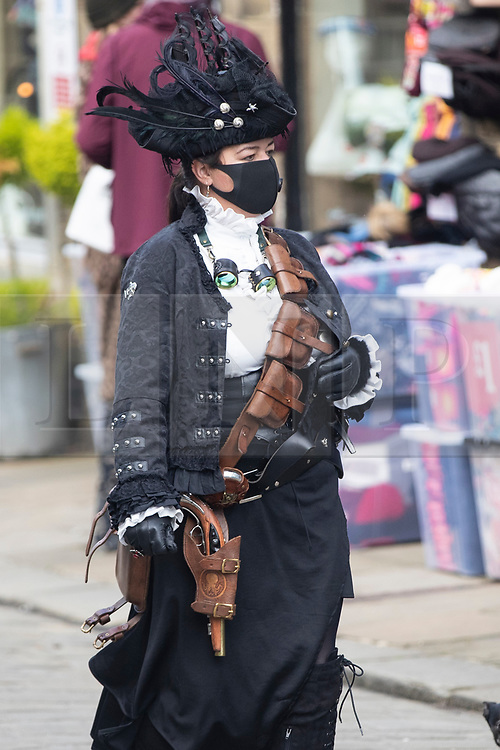 © Licensed to London News Pictures. 10/10/2020. Haworth, UK. The socially distanced Haworth Steampunk Festival takes place this year at Haworth villlage in West Yorkshire, home of the Brontë sisters. Photo credit: Kerry Elsworth/LNP