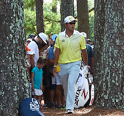 August 12, 2017 - Charlotte, North Carolina, United States - Hideki Matsuyama looks to hit out of the rough on the 8th hole during the third round of the 99th PGA Championship at Quail Hollow Club. (Credit Image: © Debby Wong via ZUMA Wire)