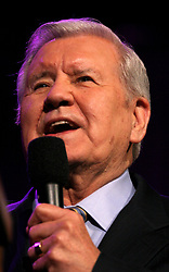 12 March 2006. New Orleans, Louisiana. <br /> Program Director for the Billy graham team, close friend of Graham, Cliff Barrows entertains the crowds before the Rev Billy Graham takes the stage. Claiming this to be his last event preaching from the pulpit, the world's most famous evangelist, The Reverend Billy Graham later addressed a capacity crowd at the New Orleans Arena as he brings his 'Celebration of Hope' weekend event to an end.<br /> Photo©; Charlie Varley/varleypix.com