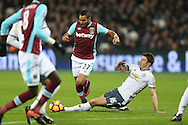 Michael Carrick of Manchester United tackles Dimitri Payet of West Ham United. Premier league match, West Ham Utd v Manchester Utd at the London Stadium, Queen Elizabeth Olympic Park in London on Monday 2nd January 2017.<br /> pic by John Patrick Fletcher, Andrew Orchard sports photography.