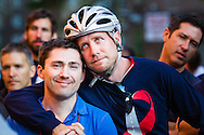 A rider and his partner feel the emotion at the closing ceremony for Braking AIDS Ride, the AIDS ride from Boston to New York that benefits Housing Works.
