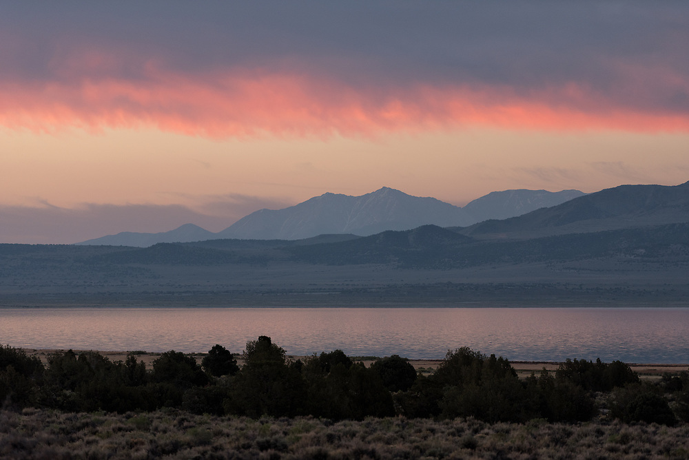 The sun accents clouds on a morning at Mono Lake