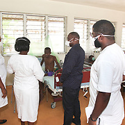 INDIVIDUAL(S) PHOTOGRAPHED: From left to right: N/A, N/A, Ndiama Abasi Idongesit, N/A, and N/A. LOCATION: Tuberculosis Hospital, Calabar, Cross River, Nigeria. CAPTION: Nurses carry out daily examinations of tuberculosis patients staying in the isolation ward. These serve to monitor the evolution and spread of the disease.