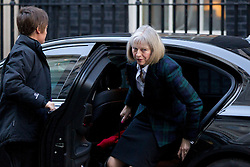 © Licensed to London News Pictures. 26/11/2013. London, UK. Theresa May, the Home Secretary, arrives for a meeting of British Prime Minister David Cameron's Cabinet on Downing Street in London today (26/11/2013). Photo credit: Matt Cetti-Roberts/LNP