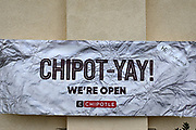 An open for business sign at Chipotle restaurant in Inglewood, Calif, Sunday, June 28, 2020, in Inglewood, Calif.