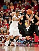 Nov 16, 2011; Fayetteville, AR, USA;  Arkansas Razorbacks guard Rickey Scott (3) makes a pass under pressure from Oakland Grizzlies forward Corey Petros (42) during a game at Bud Walton Arena. Arkansas defeated Oakland 91-68. Mandatory Credit: Beth Hall-US PRESSWIRE