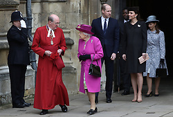 The Duke and Duchess of Cambridge and Queen Elizabeth II, leave following the Easter Mattins Service at St George's Chapel, Windsor Castle, Windsor.
