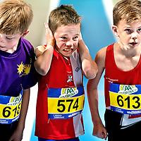 SERIE ROOKIE<br /> Nederland, Apeldoorn, 22-02-2015.<br /> Ateletiek, NK Indoor.<br /> Start Kids Run waarbij nr 574 bang is voor het startschot.<br /> Hij zal overigens wel zijn serie winnen.<br /> Foto: Klaas Jan van der Weij