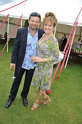 ANDY SERKIS and LORRAINE ASHBOURNE at the Cartier Queen's Cup Polo Final, Guards Polo Club, Windsor Great Park, Berkshire, on 17th June 2012.