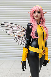 © Licensed to London News Pictures. 20/02/2016. London, UK. A girl dressed as The Wasp is amongst the fans gathered at the London Super Comic Convention at the Excel Centre in Docklands.  Many have dressed in homemade costumes which have taken hours to make with great attention to detail.<br />  Photo credit : Stephen Chung/LNP