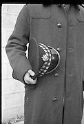 Peter Hughes in Guard Uniform.   B269..1960..06.01.1960..01.06.1960..6th January 1960..Pictured strolling through Dublin was Mr Peter Hughes resplendent in his Guards Uniform...Picture shows Peter in his greatcoat displaying his hat with badge.