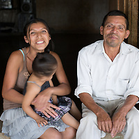 """Jesus the Indigenous Leader<br /> <br /> Jesús Pérez, Corralito, Copán<br /> <br /> """"I live here in Los Altos de Corralito, where I was born, high up in the mountains. I plant corn and beans, and sometimes I earn some money working as a labourer. I have six living daughters, and two living sons. And I have five or six grandchildren. <br /> <br /> Our community has a history of struggle for land and for recognition of our indigenous identity, and my family has paid dearly for it. Blood has been spilt for our indigenous rights.<br /> <br /> My nephew was Candido Amador. He was two days older than me. The Maya Chortí communities were marginalised by the big landowners, but thank God, now we have official recognition as an indigenous people, and we have a little bit of land. We've been here for thousands of years, but we only got recognition in the last twenty years.<br /> <br /> My nephew gave his life for our cause. They assassinated him.<br /> <br /> He had long hair, he dressed in indigenous clothes, and had very indigenous features. They thought he was the leader and representative of the indigenous movement, so they targeted him. In fact he wasn't the representative. The person who represented our organisation was compañera María de Jesús Interiano. She was the first elected President of the Council, while we were preparing for the first Congress. But they thought that Candido was the leader and that's why they assassinated him. <br /> He was beaten, he was cut with a machete on his hands, his neck, his head, and he was shot three times in the chest. And they scalped him. <br /> <br /> It was the night of the 11th of April 1997. He lived in my house, so they came here to get me to identify the body. He had been thrown on the side of the road. We brought him up here to the Catholic church to say prayers, for a wake. <br /> <br /> He is buried in Rincón del Buey. One of my own sons is buried next to him. He had a fall while he was working in the town, and died of th"""