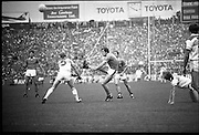 The All Ireland Senior Football Final.1982.19.09.1982.09.19.1982.19th September 1982..The senior final was contested between Offaly and Kerry. Offaly won the title by the narrowest of margins 1.15 to 17 points..Tom Spillane,despite the efforts of pat fitzgerald gets in a strike at goal.