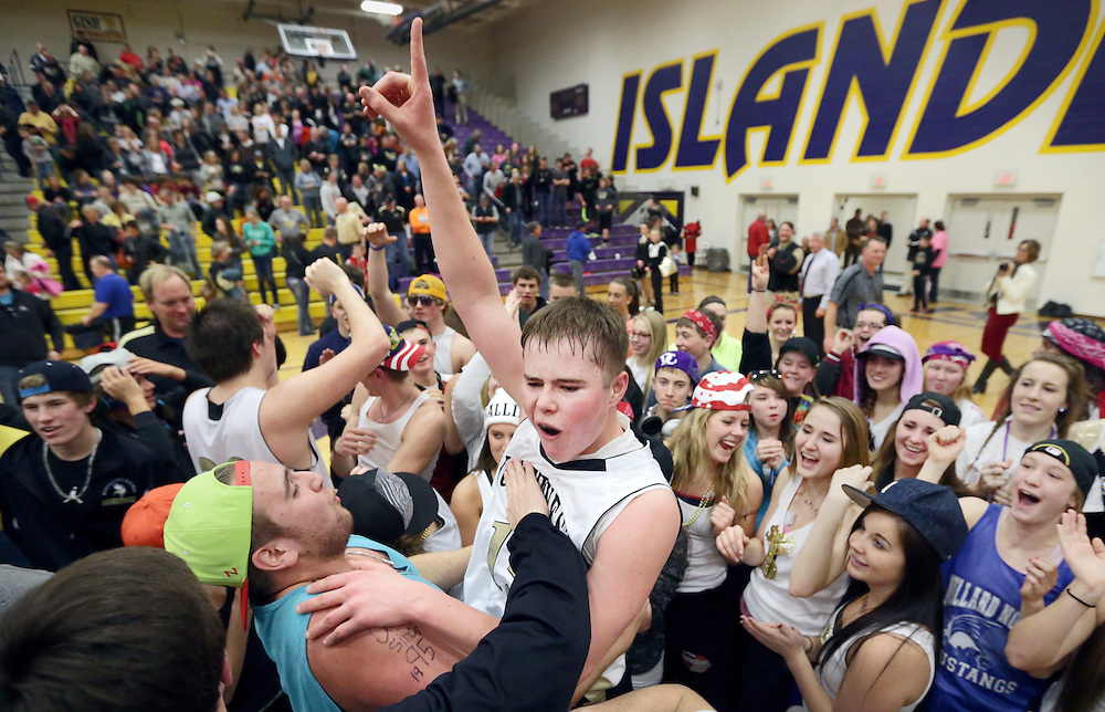 Grand Island Northwest's Christian Ellsworth is mobbed by his classmates after the Vikings defeat Aurora 33-31 in Tuesday's B-5 district championship at Grand Island Senior High. (Independent/Matt Dixon)