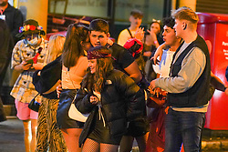 © Licensed to London News Pictures. 29/10/2020. Nottingham, UK. Revellers in Halloween costumes enjoy a night out in the city centre before new restrictions come into force in Nottingham. The county of Nottinghamshire will enter into Tier 3 ,from 00:01 am on Friday 30 October.  Photo credit: Ioannis Alexopoulos/LNP