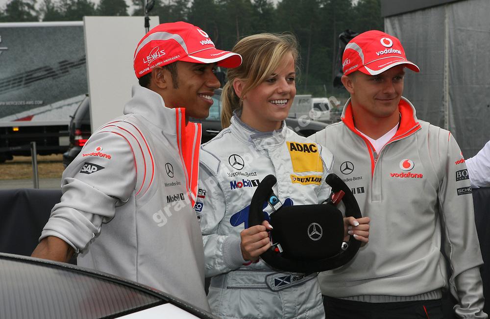 Heikki Kovalainen (McLaren-Mercedes) with Susie Stoddart and Lewis Hamilton before the 2008 German Grand Prix in Hockeheim. Photo: Grand Prix Photo