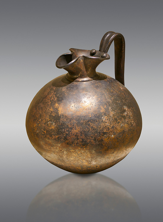Phrygian bronze trefoil spouted jug from Gordion . Phrygian Collection, 8th century BC - Museum of Anatolian Civilisations Ankara. Turkey. .<br /> <br /> If you prefer you can also buy from our ALAMY PHOTO LIBRARY  Collection visit : https://www.alamy.com/portfolio/paul-williams-funkystock/phrygian-antiquities.html  - Type into the LOWER SEARCH WITHIN GALLERY box to refine search by adding background colour, place, museum etc<br /> <br /> Visit our CLASSICAL WORLD PHOTO COLLECTIONS for more photos to download or buy as wall art prints https://funkystock.photoshelter.com/gallery-collection/Classical-Era-Historic-Sites-Archaeological-Sites-Pictures-Images/C0000g4bSGiDL9rw