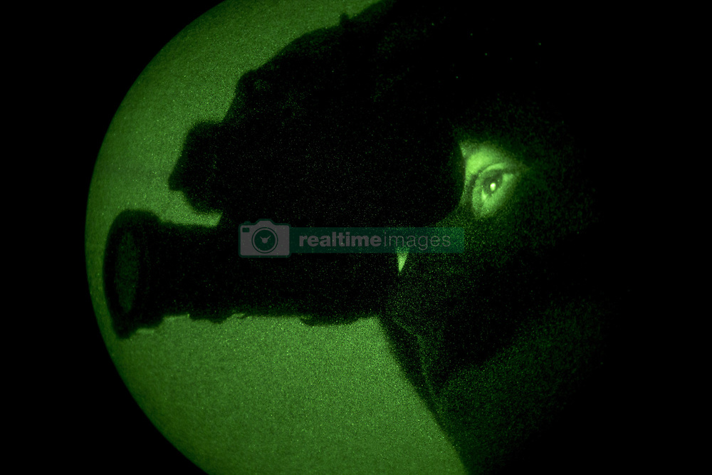 Apr 27, 2017 - Chocolate Mountain Gunnery Range, California, U.S. - Night Sight. Marine Corps Sgt. PAUL GUILLEN uses his night vision goggles during a weapons and instructor course final exercise at the Chocolate Mountain Aerial Gunnery Range in California, April 27, 2017. Guillen is a crew chief assigned to Marine Light Attack Helicopter Squadron 169. Marine Corps photo by Cpl. AaronJames B. Vinculado. (Credit Image: ? AaronJames Vinculado/Marines/DoD via ZUMA Wire/ZUMAPRESS.com)