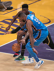 February 8, 2018 - Los Angeles, California, U.S - Kentavious Caldwell-Pope #1 of the Los Angeles Lakers scrambles for the ball with Patrick Patterson #54 and Daniel Hamilton #25 of the Oklahoma Thunder during their NBA game on Thursday February 8, 2018 at the Staples Center in Los Angeles, California. Lakers vs. Thunder. (Credit Image: © Prensa Internacional via ZUMA Wire)