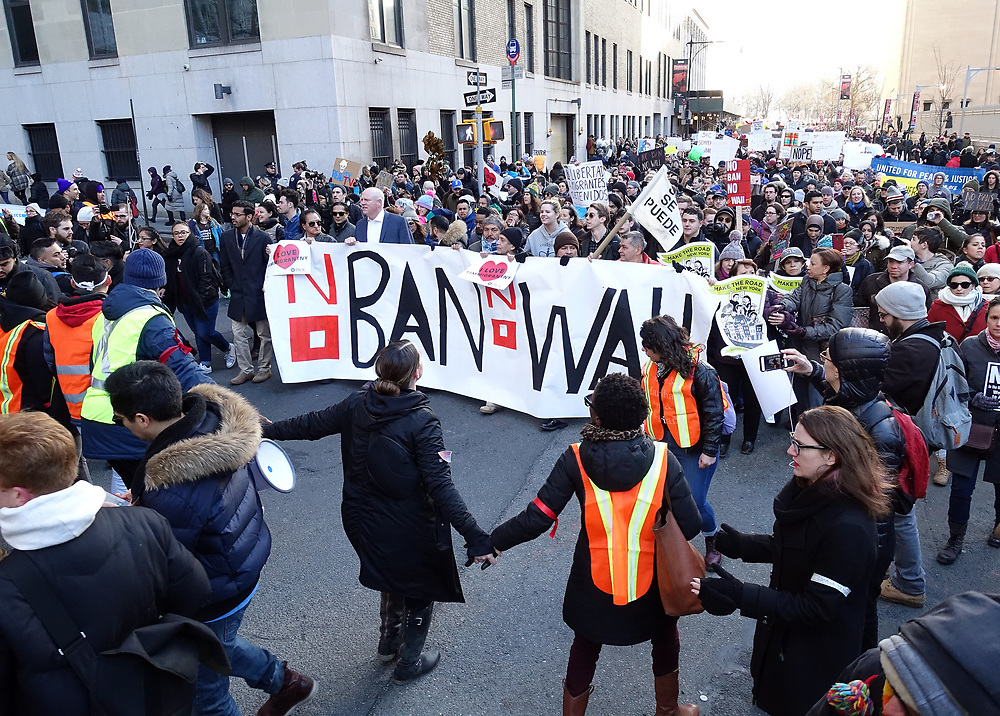 Over 10,000 marched from Battery Park on in New York City to voice opposition to President Donald Trump's proposed travel ban.