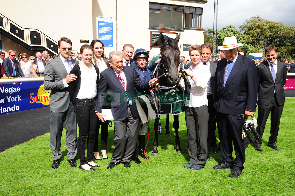 Jockey Seamus Heffernan in the winners enclosure with the connections of Caravaggio after victory in the Keeneland Phoenix Stakes at Curragh Racecourse, Co. Kildare, Ireland.
