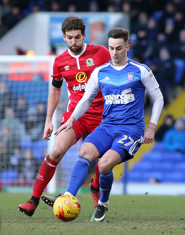 Ipswich Town's Tom Lawrence is chased down by Blackburn Rovers' Charlie Mulgrew<br /> <br /> Photographer David Shipman/CameraSport<br /> <br /> The EFL Sky Bet Championship - Ipswich Town v Blackburn Rovers - Saturday 14th January 2017 - Portman Road - Ipswich<br /> <br /> World Copyright © 2017 CameraSport. All rights reserved. 43 Linden Ave. Countesthorpe. Leicester. England. LE8 5PG - Tel: +44 (0) 116 277 4147 - admin@camerasport.com - www.camerasport.com
