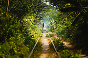 """A """"bamboo train"""" or """"Norry"""" consists of a platform made of bamboo laid upon old train wheels. Local people still use them as a means of transport, utilising the abandoned rails."""
