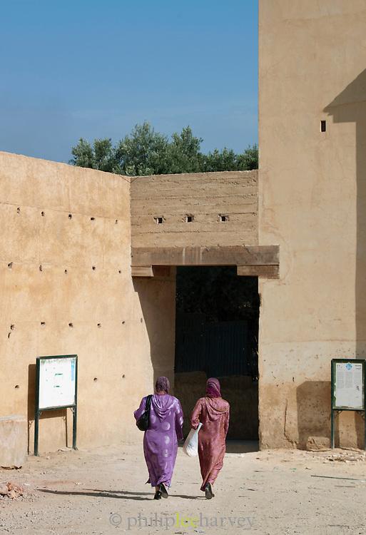 Women walk into the medina of Fes, Morocco