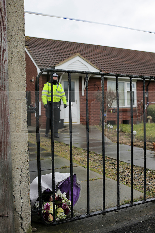 © Licensed to London News Pictures. 24/03/2016. Redcar, UK. Flowers left at the scene of a double murder in Redcar, North Yorkshire. The bodies of two women where found at the property and a 34-year-old man has been arrested on suspicion of two counts of murder  Photo credit: Stuart Boulton/LNP