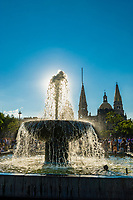A water fountain in the Plaza de Armas, with the Metropolitan Cathedral in background, the historic Center of Guadalajara, Jalisco, Mexico