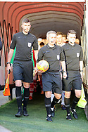 The Referee Darren Bond and his Assitants enter the field of play  during the EFL Sky Bet League 1 match between Barnsley and Charlton Athletic at Oakwell, Barnsley, England on 29 December 2018.