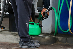 © Licensed to London News Pictures. 28/09/2021. London, UK. A Royal Mail staff member fills a petrol can on the fifth day of the fuel crisis at Sainsbury's petrol station in north London, amid fears of fuel running out due to a shortage of HGV drivers. The Army is on standby to help ease the fuel supply crisis. Photo credit: Dinendra Haria/LNP
