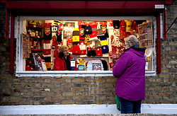A general view of a street vendor selling match related merchandise prior to the beginning of the Premier League Match at Emirates Stadium