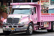 Bright pink builders' truck painted In Loving Memory of Linda - Linda's Angels in New York City, USA