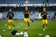 Burton Albion defender Stephen Warnock (3), Burton Albion defender Ben Turner (6) and Burton Albion defender Kyle McFadzean (5) warm up during the EFL Sky Bet Championship match between Queens Park Rangers and Burton Albion at the Loftus Road Stadium, London, England on 23 September 2017. Photo by John Potts.
