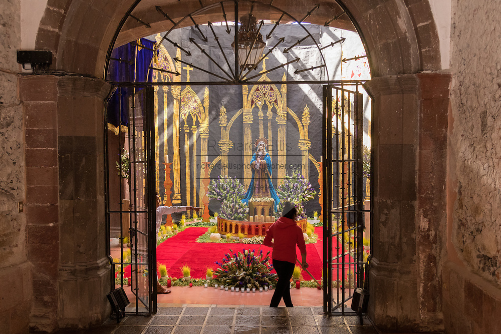 A Mexican woman prepares an altar celebrating El Viernes de Dolores during Holy Week March 23, 2018 in San Miguel de Allende, Mexico. The event honors the sorrow of the Virgin Mary for the death of her son and is an annual tradition in central Mexico.