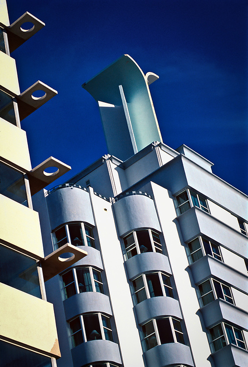 Designed in 1940 by Roy France in the Art Deco style, the Sea Isle Hotel (also known as the Miami Beach Ocean Resort) boasts a remarkable ornamental crown. And to its left is the San Souci Hotel, designed by France and Morris Lapidus in 1949 in a newer Miami Modern (MiMo) style.