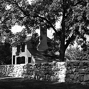The historic Ebert House is shrouded by trees and a stone wall along Sunken Road in Fredericksburg VA.